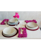 Table setting featuring fuchsia napkins with fringes